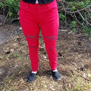 Cherry red distressed skinny jeans